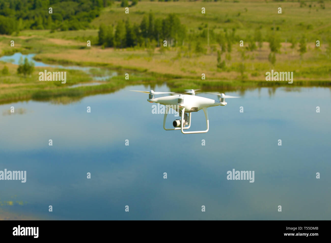 PSKOV REGION, RUSSIA - JUNE, 2018: Flying quadrocopter 'Phantom' on the background of the summer lake - Stock Image