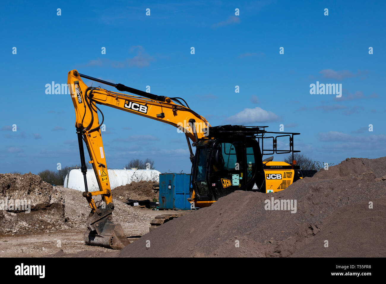 construction site excavators parked on earthworks on building site - Stock Image