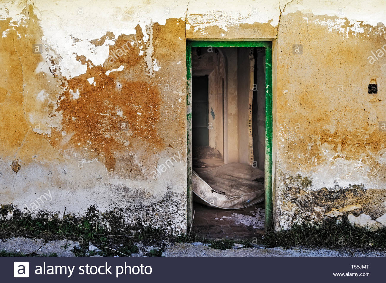 Entrance door to an old abandoned country house - Stock Image