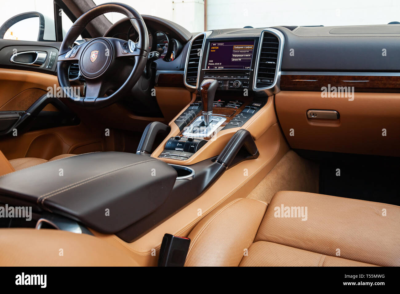 Novosibirsk, Russia - 04.12.2019: The interior of the car Porsche Cayenne 958 2011 year with a view of the steering wheel, dashboard, seats and multim - Stock Image