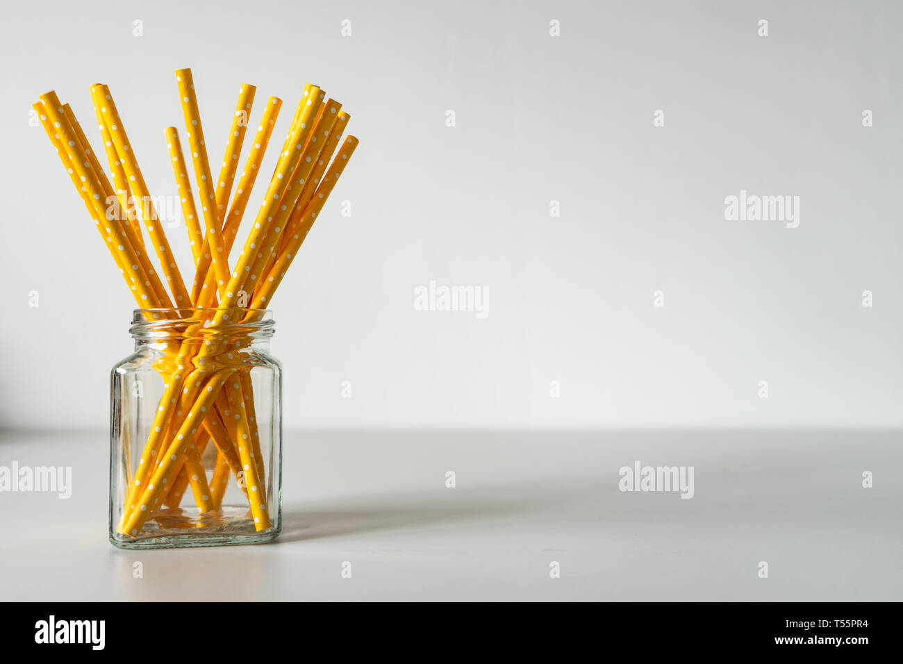 Yellow paper straws isolated on white background Stock Photo