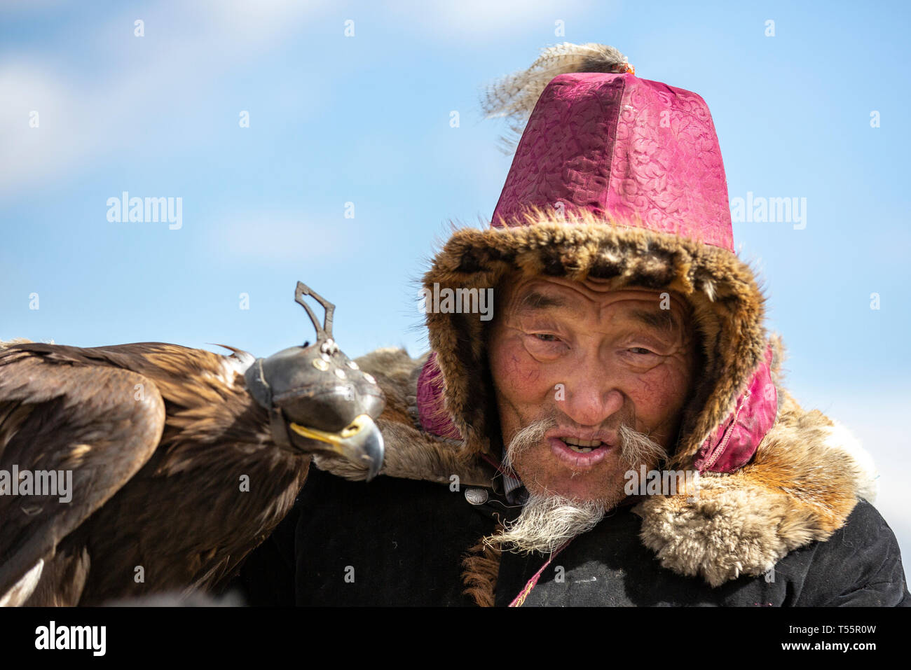 bayan Ulgii, Mongolia, 3rd October 2015: kazakh eagle hunter with his bird Stock Photo