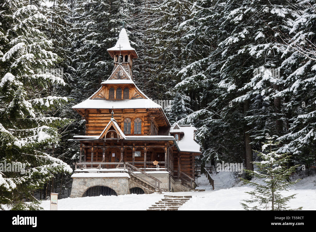 Chapel of the Sacred Heart of Jesus in snow in Jaszczurowka, Poland - Stock Image