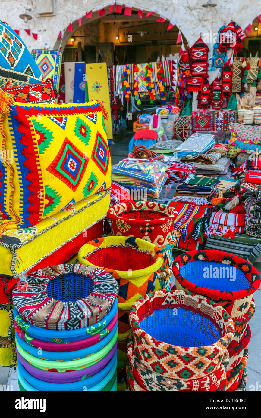 Bright textiles in market in Doha, Qatar - Stock Image
