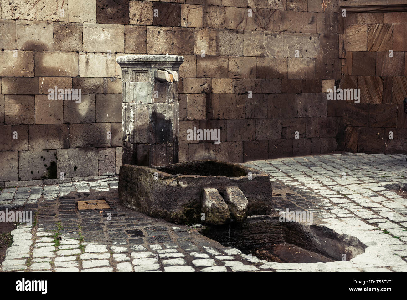 Ancient stone washbasin - Stock Image
