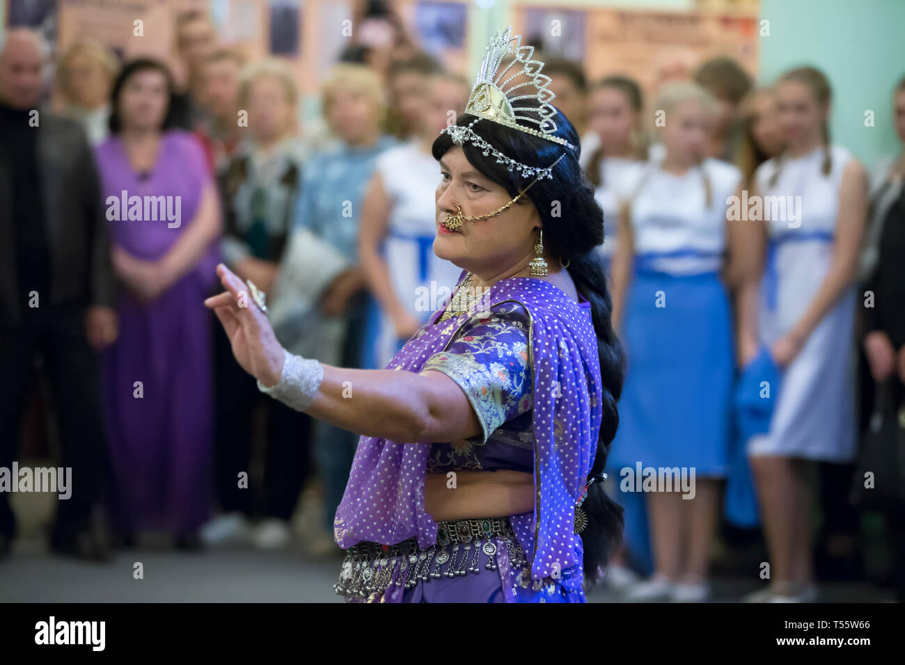 Belarus, the city of Gomel September 15, 2016, the central library.Night of museums.The old woman dances Indian dances. Active aging - Stock Image