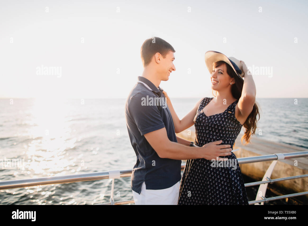 Young couple on pier Stock Photo