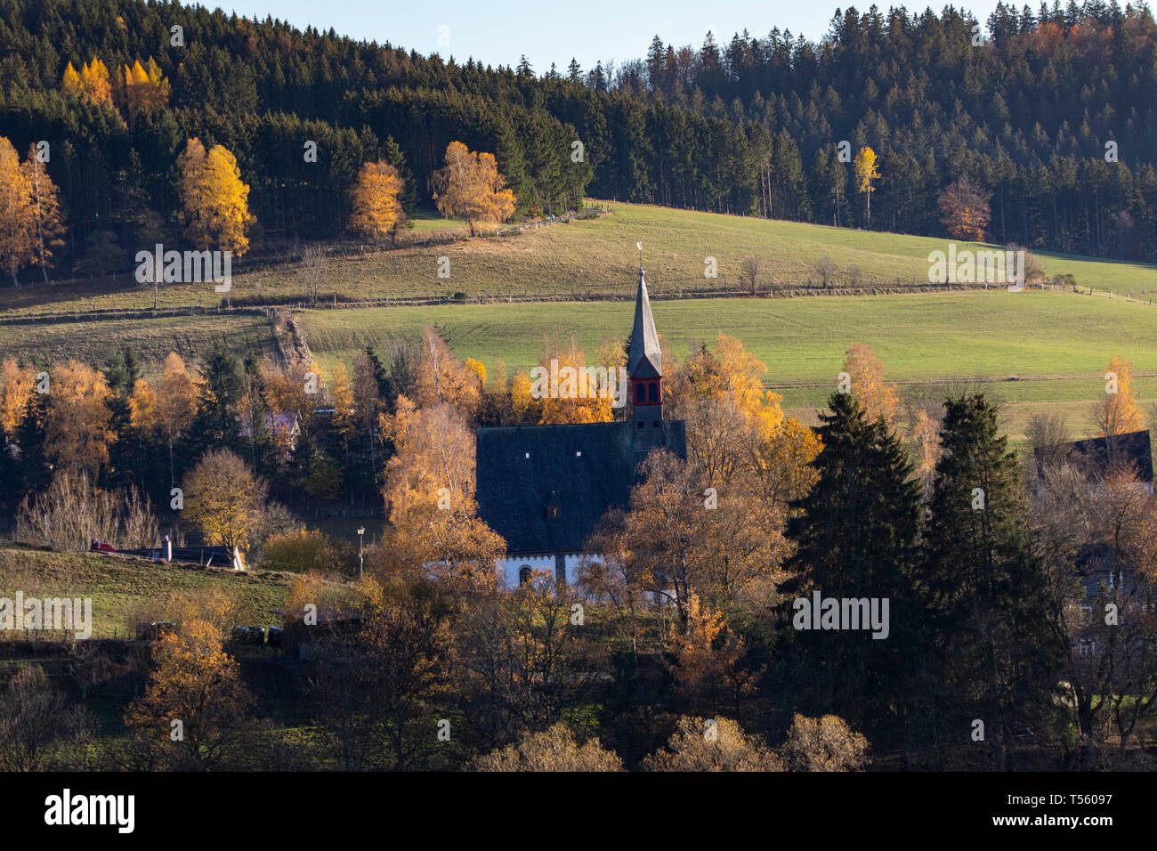 Autumn forest, small church at SchŸllar, near Bad Berleburg, Siegen district Wittgenstein, in Sauerland area, NRW, Germany, - Stock Image