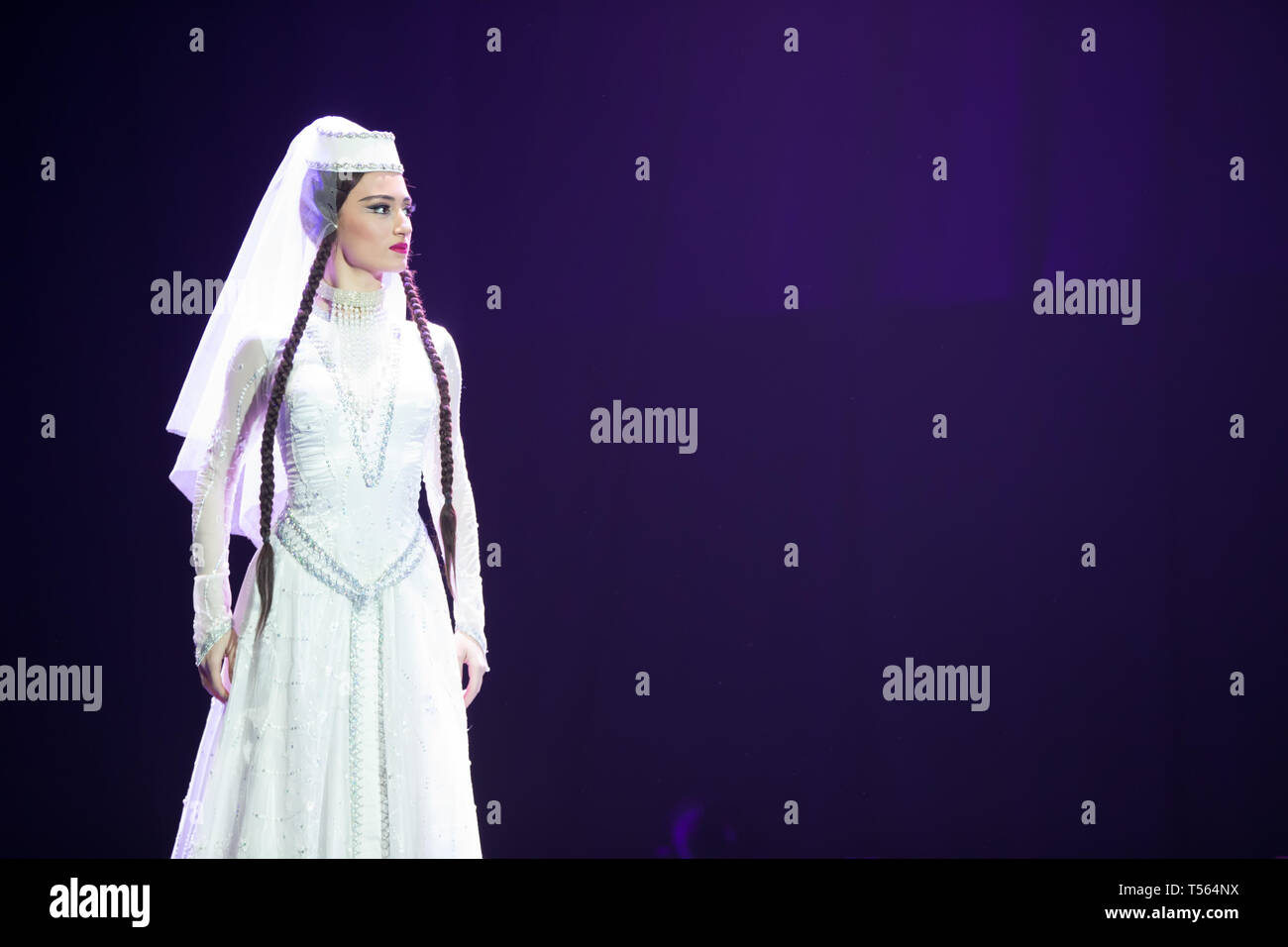 Belarus, Gomel, February 27, 2018. Concert hall. Speech of the national Georgian ballet Sukhishvili.A Georgian woman in a national white costume dance - Stock Image