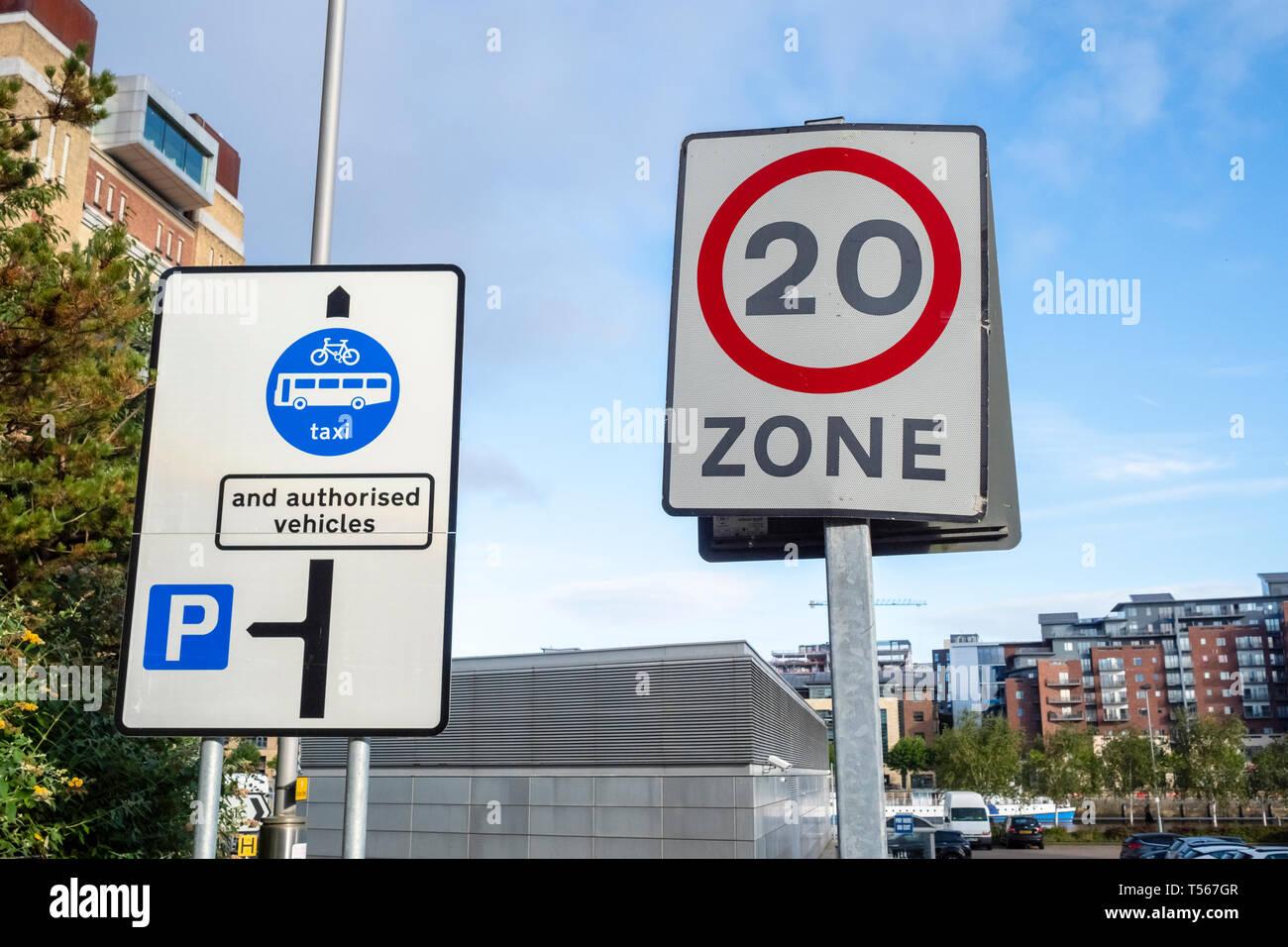 UK, road signs twenty miles per hour zone and Authorised vehicles. - Stock Image
