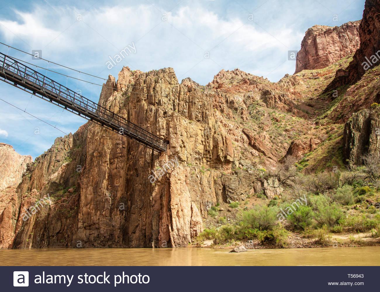 The Kaibab Suspension Bridge crosses the Colorado River in the Grand Canyon basin near Phantom Ranch in Arizona. - Stock Image