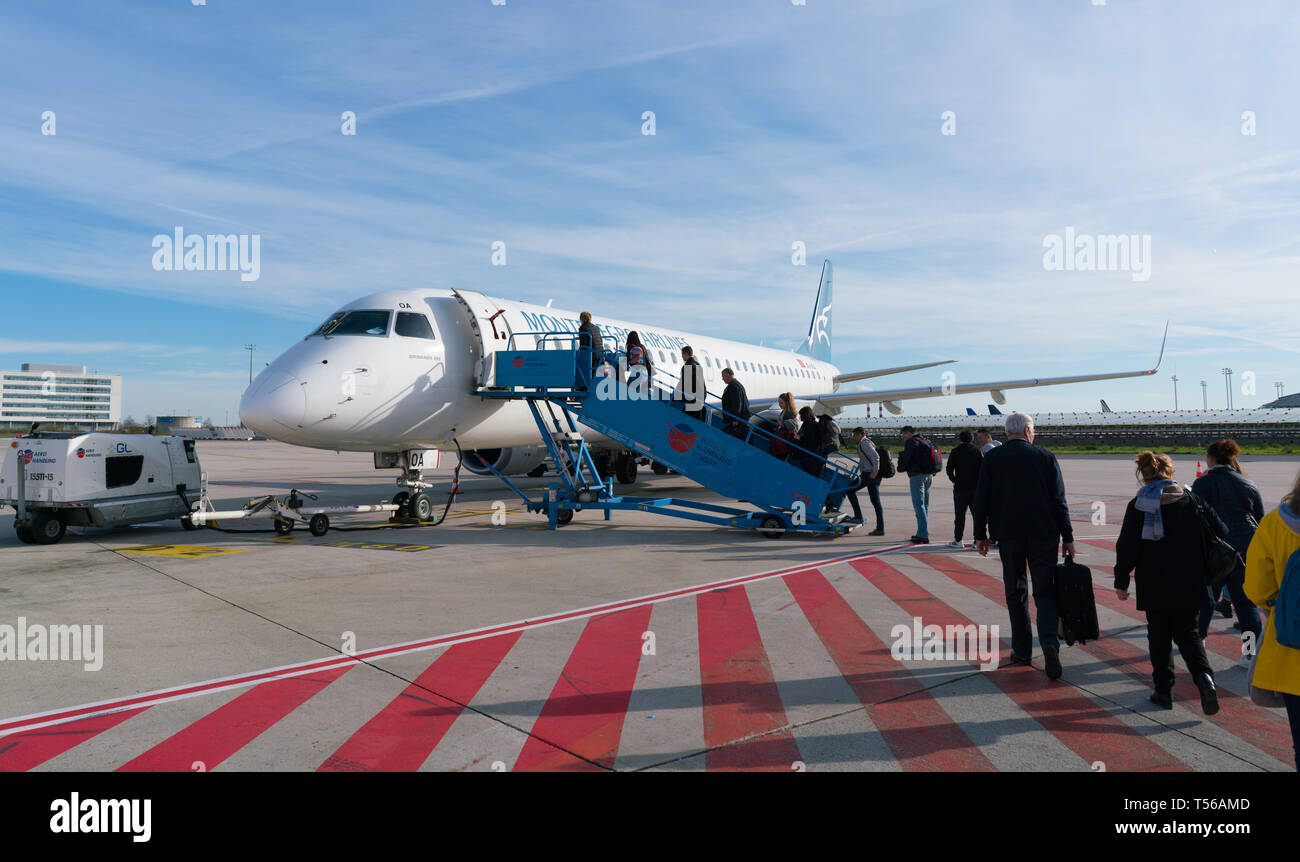 Paris, France - April 5, 2019: plane Embraer ERJ-195LR 4O-AOA of montenegro airlines at Charles de Gaulle Airport Stock Photo