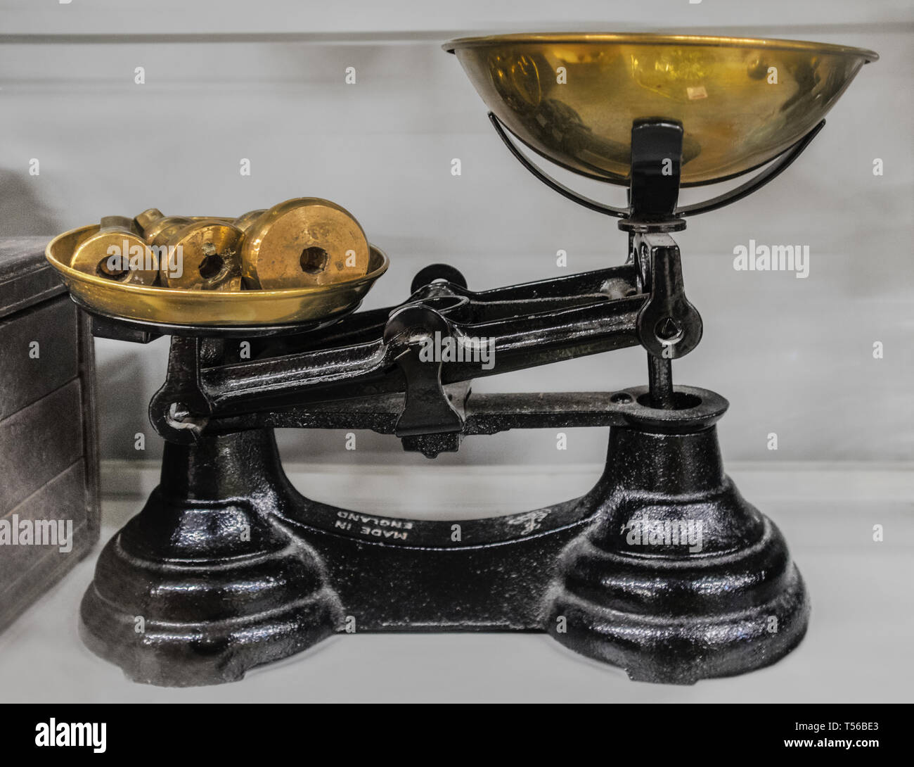 Antique balance scale with brass masses. - Stock Image