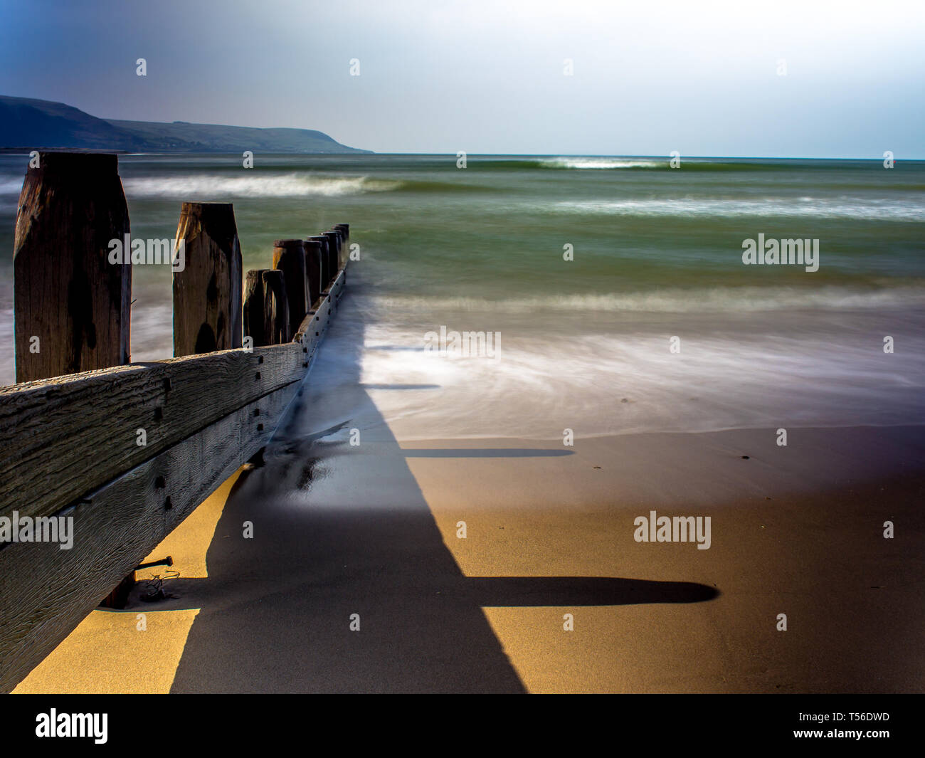 Barmouth beach uk, in summer with a long exposed shot - Stock Image