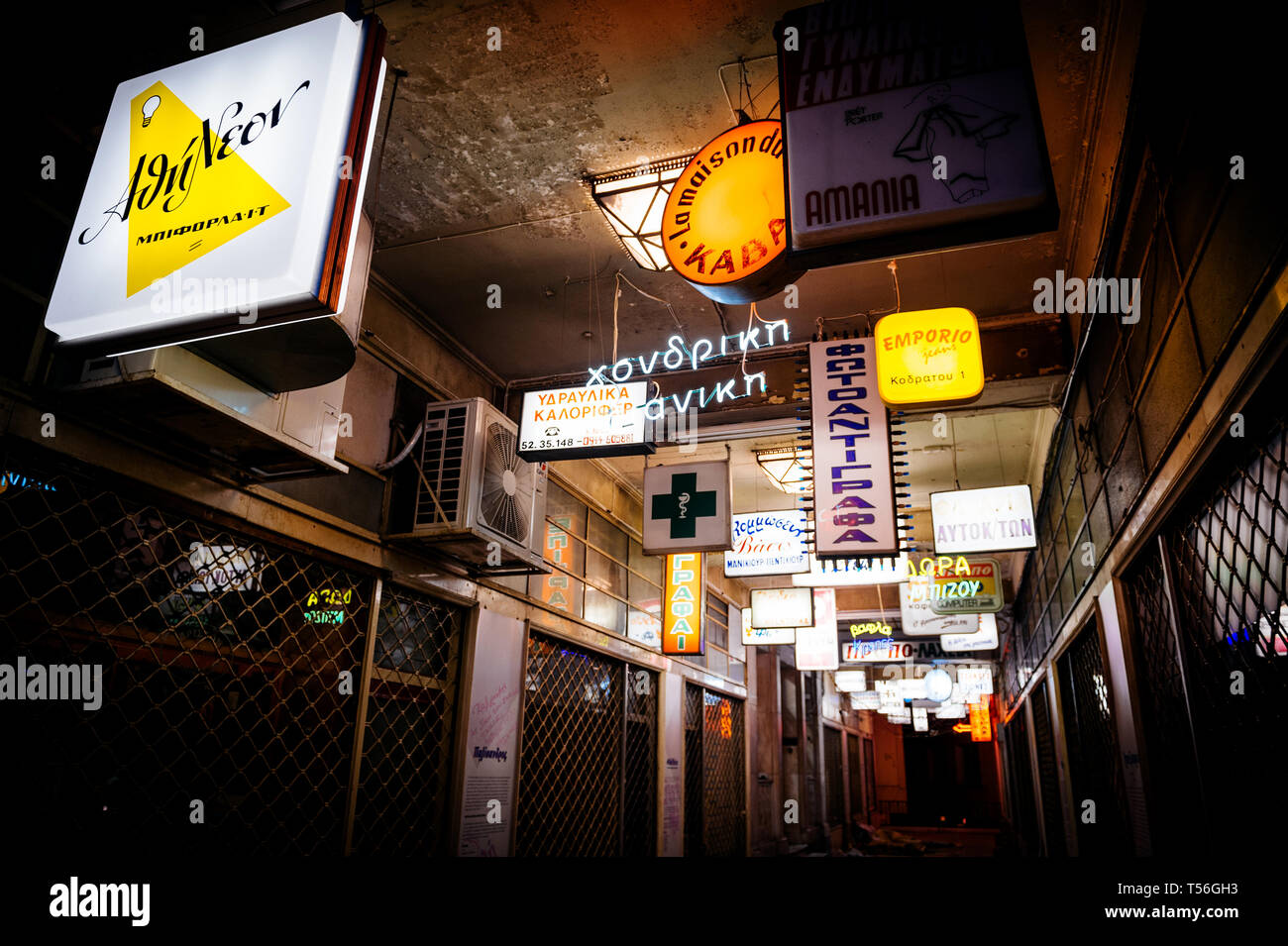 Athens, Greece - 26 Mar 2016: Multiple busines signs totmes and firms logotypes on the passage in central Athens on Kolokotroni 3, Athina 105 62 - Stock Image
