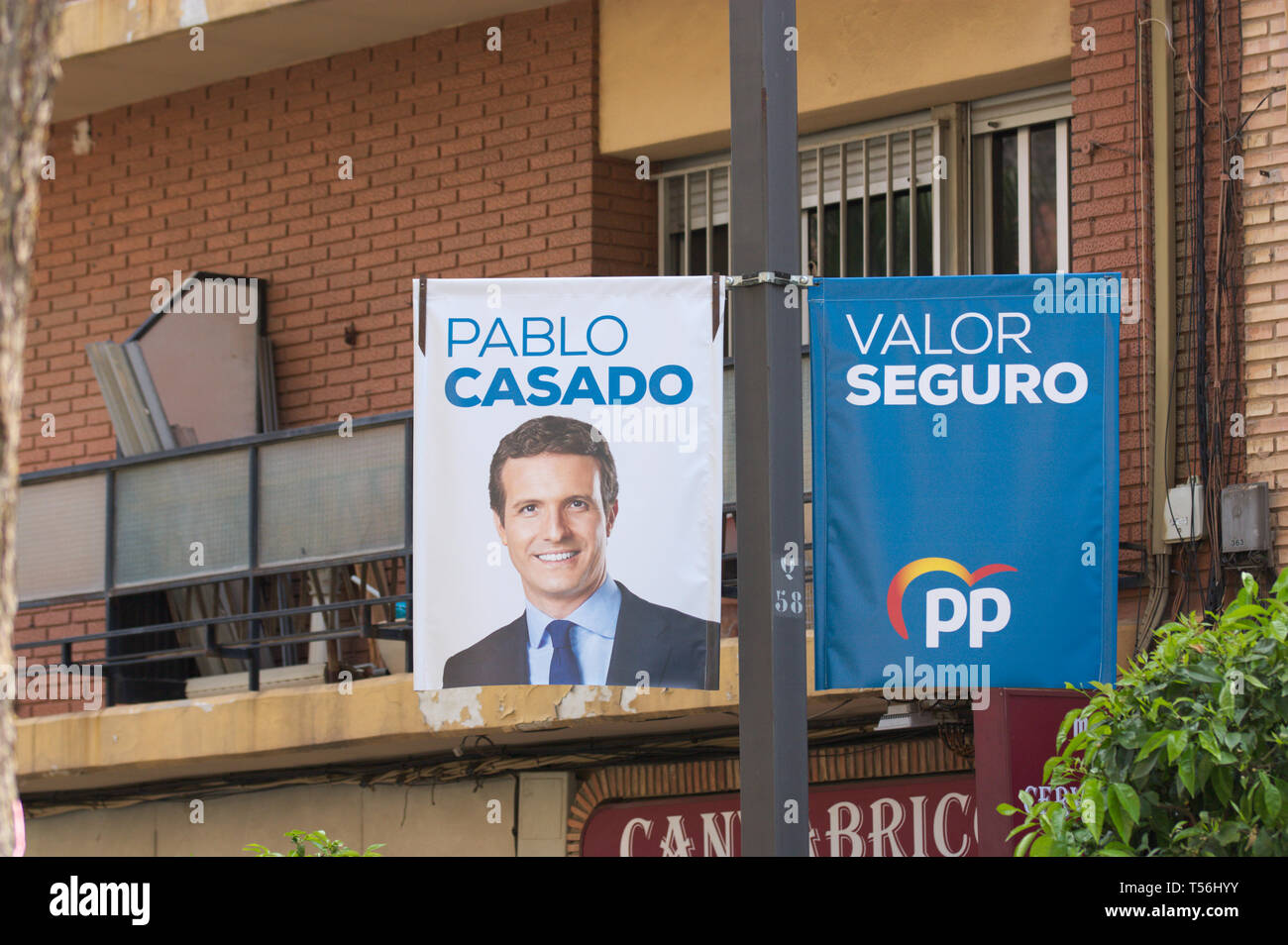 2019. April. Spain. Banners of electoral propaganda 'Partido Popular' for elections to Congress where the portrait of his candidate for President of t - Stock Image