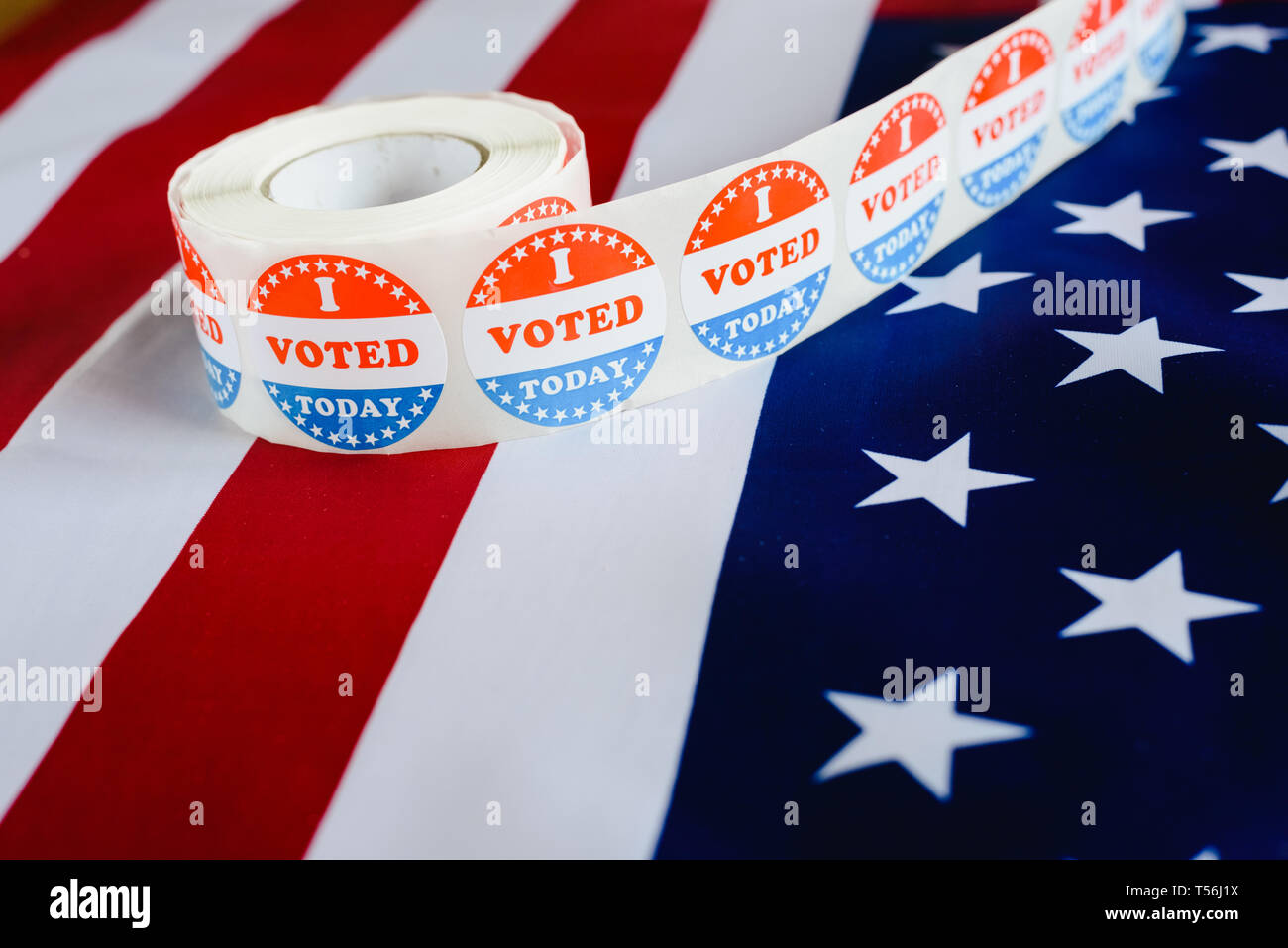 I voted today sticker, typical of US elections on American flag. Stock Photo