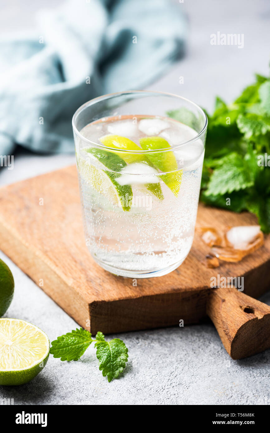 Alcohol free sparkling mojito, soda water with lime and mint. Healthy refreshing summer ice cold drink Stock Photo