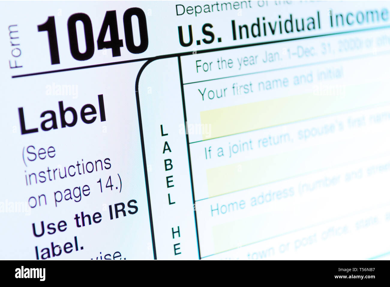 Income Tax Return Deduction Form 1040 on Computer Monitor. Refund Concept. Copy space for your text - Stock Image