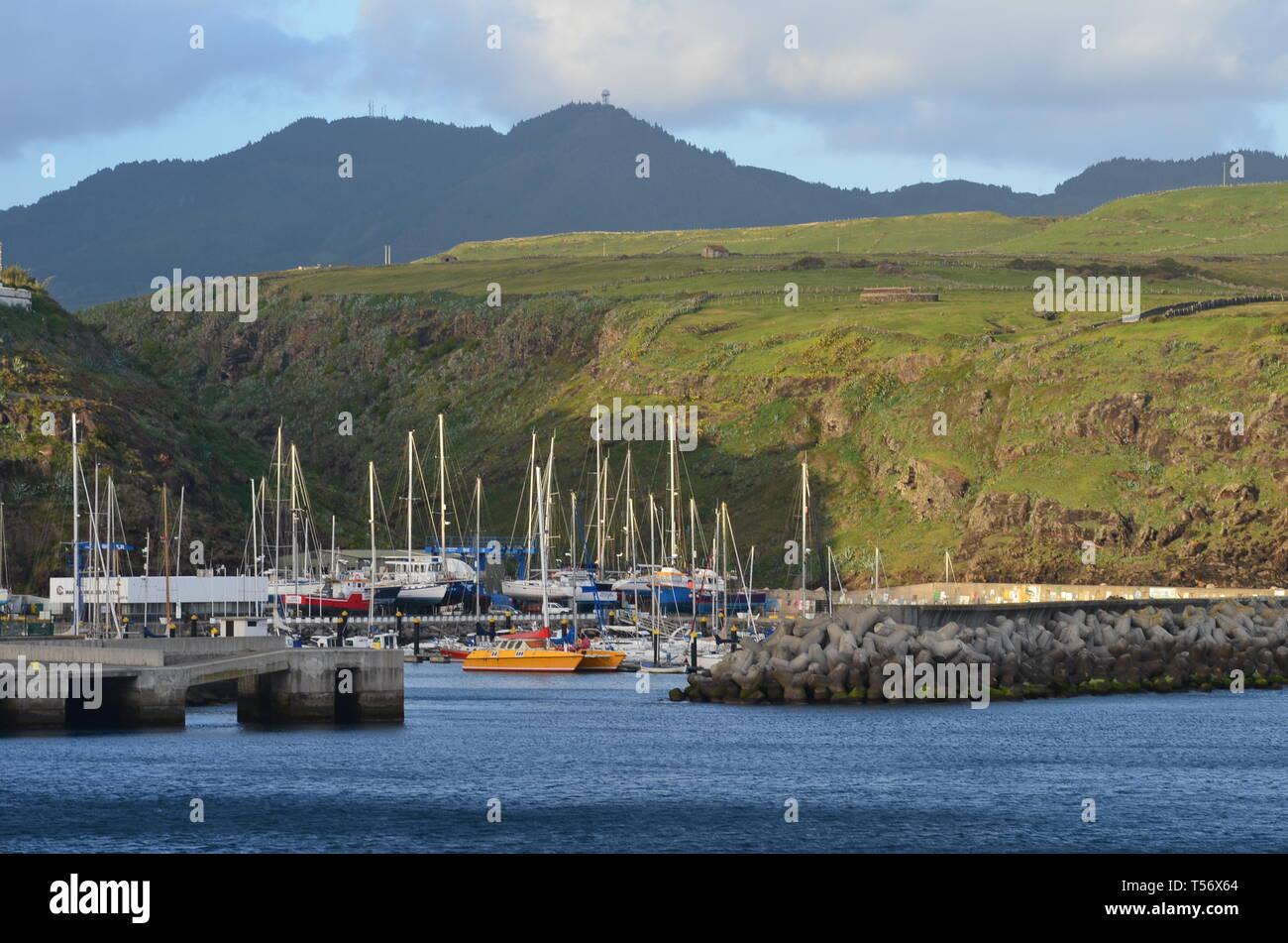 Yachts moored at the marina of Vila do Porto, administrative centre of Santa Maria island, Azores Stock Photo