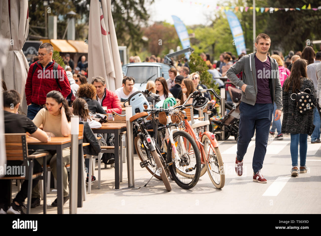 Bucharest, Romania: 21.04.2019 - Street Food Truck festival. Parked by the table bicycles at a food street festival in the park while the owners are having lunch. Relaxing people in their spare time - weekend activities - Stock Image