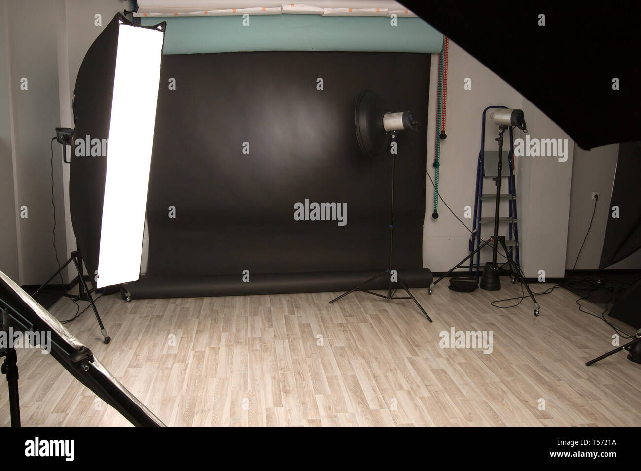 Empty photo Studio with a variety of lighting equipment. photo with copy space - Stock Image