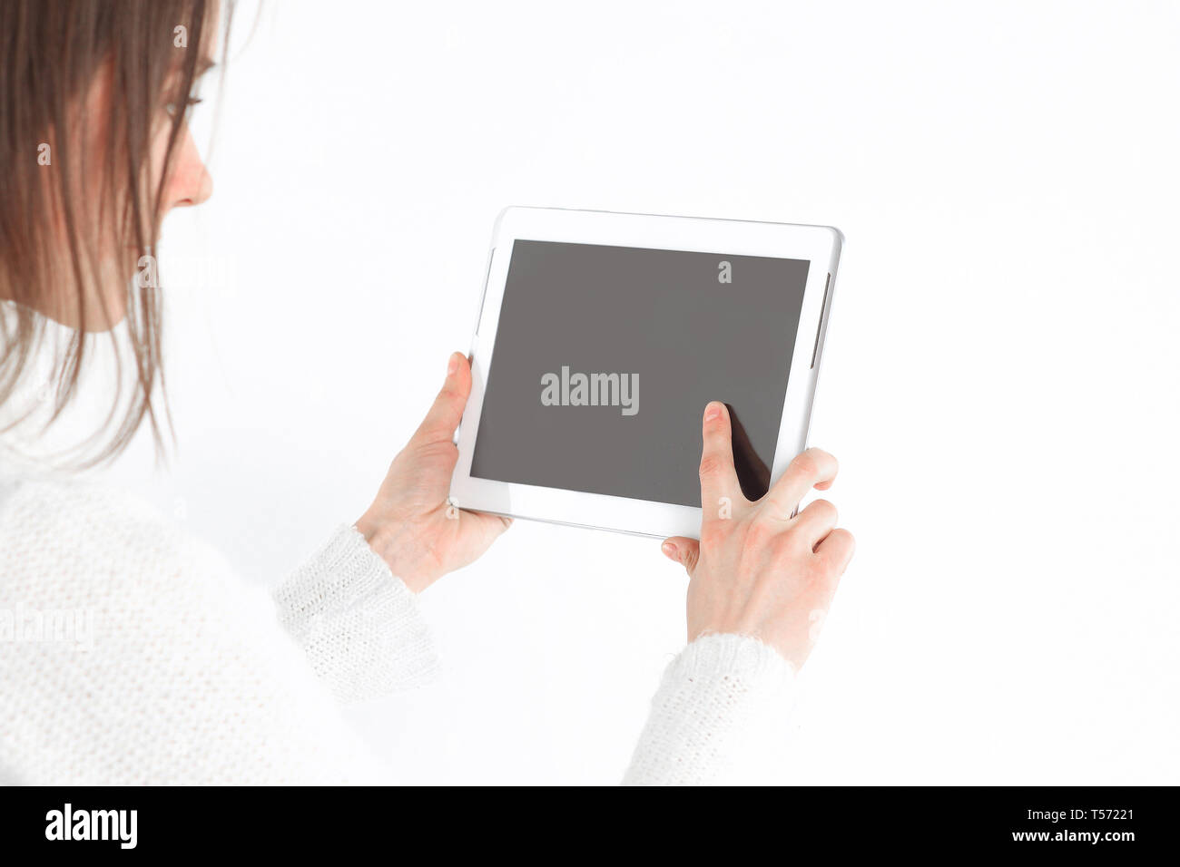 close up. young woman tapping the screen of digital tablet.photo with copy space. - Stock Image