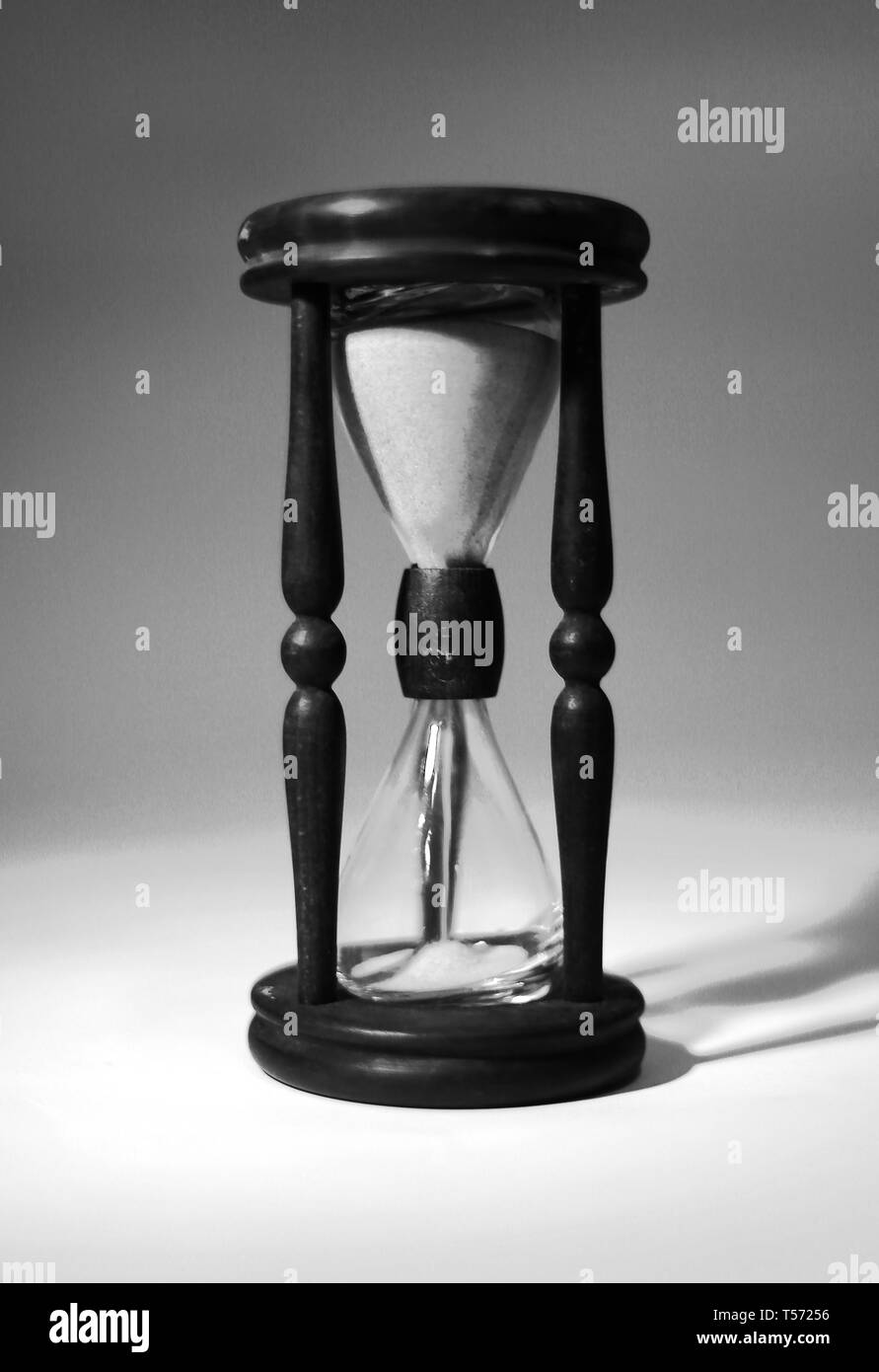 closeup of hourglass. isolated on blue background.photo with copy space - Stock Image