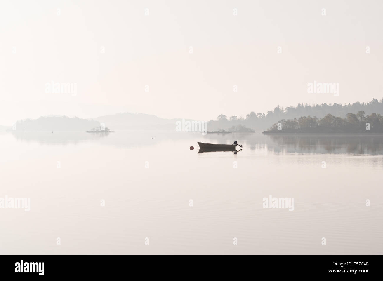 Luss, Loch Lomond, Scotland, UK. 22nd Apr, 2019. uk weather - a glorious still and hazy morning at Luss, Loch Lomond ahead of what is forecast to be a beautiful sunny day Credit: Kay Roxby/Alamy Live News Stock Photo
