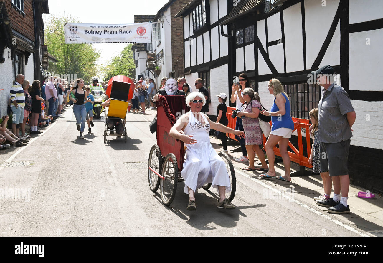 Bolney Sussex, UK. 22nd Apr, 2019. Competitors take part in the annual Bolney Pram Race in hot sunny weather . The annual races start and finish at the Eight Bells Pub in the village every Easter Bank Holiday Monday Credit: Simon Dack/Alamy Live News Stock Photo