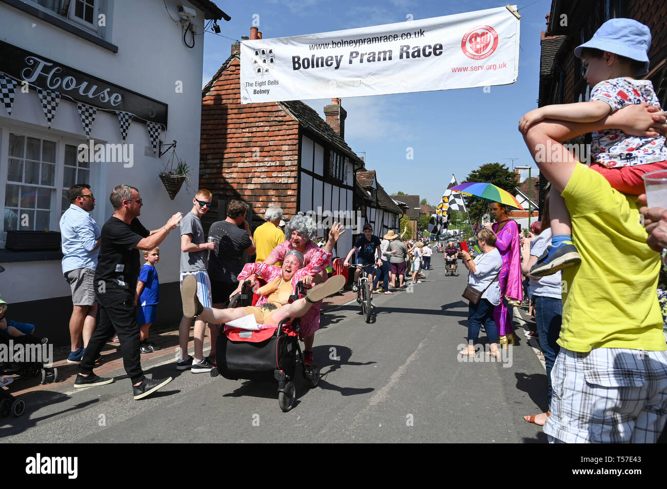 Bolney Sussex, UK. 22nd Apr, 2019. Competitors celebrate finishing the annual Bolney Pram Race in hot sunny weather . The annual races start and finish at the Eight Bells Pub in the village every Easter Bank Holiday Monday Credit: Simon Dack/Alamy Live News Stock Photo