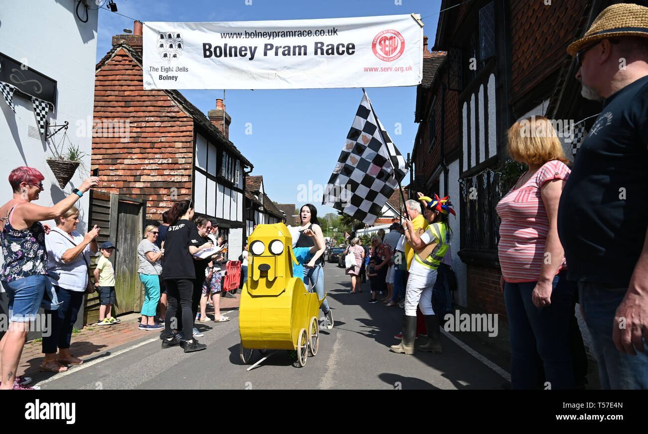 Bolney Sussex, UK. 22nd Apr, 2019. Competitors in the children's race take part in the annual Bolney Pram Race in hot sunny weather . The annual races start and finish at the Eight Bells Pub in the village every Easter Bank Holiday Monday Credit: Simon Dack/Alamy Live News Stock Photo