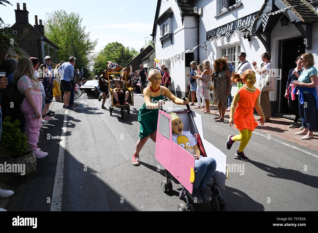Bolney Sussex, UK. 22nd Apr, 2019. The children's race in the annual Bolney Pram Race in hot sunny weather . The annual races start and finish at the Eight Bells Pub in the village every Easter Bank Holiday Monday Credit: Simon Dack/Alamy Live News Stock Photo