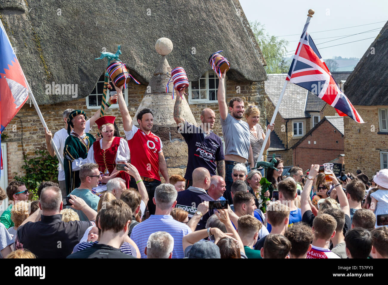 """Hallaton, Leicestershire. 22nd April 2019. Hare Pie Scramble & Bottle Kicking, this is an ancient custom in two distinct parts. The first is a procession, baskets of bread and the eponymous Hare Pie (believed to be minced beef these days), once at the church gate, the pie is blessed and distributed to the crowds and the second is a mass """"ballgame"""" played with small wooden casks called bottles between the villages of Hallaton and Melbourne. Credit: Keith J Smith./Alamy Live News - Stock Image"""