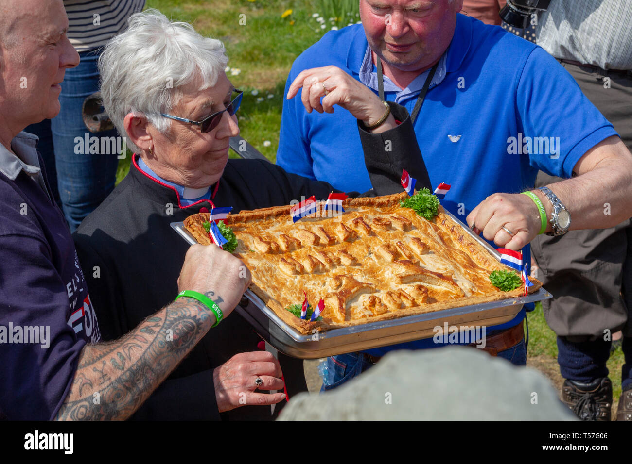 """Hallaton, Leicestershire. 22nd April 2019. Hare Pie Scramble & Bottle Kicking, this is an ancient custom in two distinct parts. The first is a procession, baskets of bread and the eponymous Hare Pie (believed to be minced beef these days), once at the church gate, the pie is blessed and distributed to the crowds and the second is a mass """"ballgame"""" played with small wooden casks called bottles between the villages of Hallaton and Melbourne. Credit: Keith J Smith./Alamy Live News Stock Photo"""