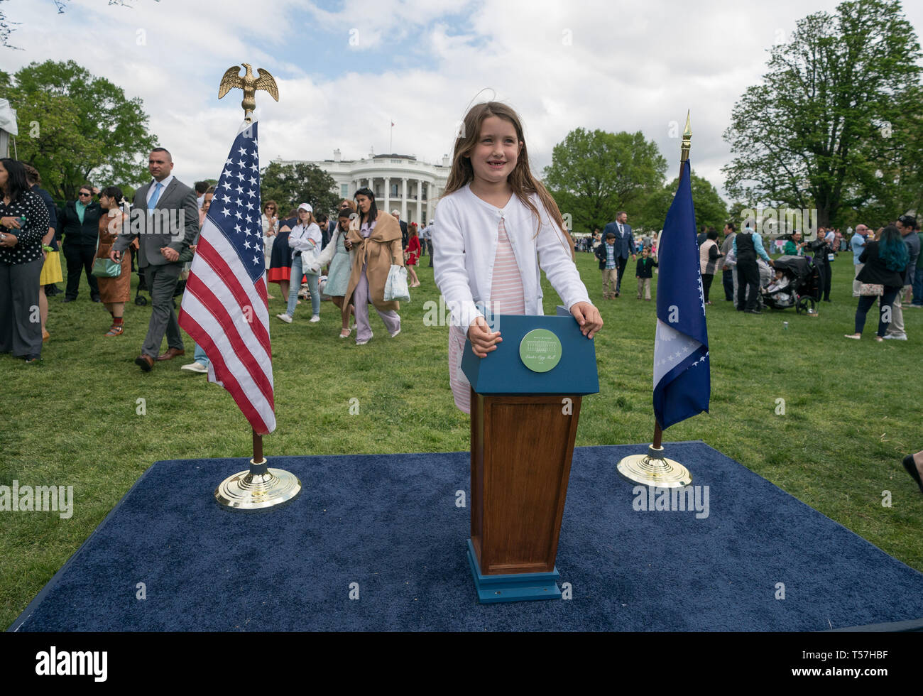 Washington, United States Of America. 22nd Apr, 2019. A child poses next to a mini podium during the White House Easter Egg Roll at the White House in Washington, DC on April 22, 2019. Credit: Kevin Dietsch/Pool via CNP | usage worldwide Credit: dpa/Alamy Live News - Stock Image