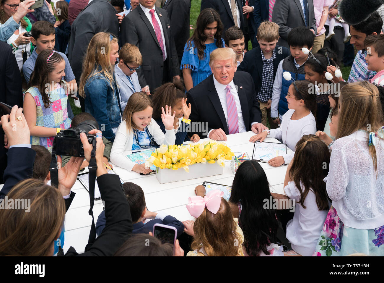Washington, United States Of America. 22nd Apr, 2019. United States President Donald J. Trump colors with children during the White House Easter Egg Roll at the White House in Washington, DC on April 22, 2019. Credit: Kevin Dietsch/Pool via CNP | usage worldwide Credit: dpa/Alamy Live News - Stock Image