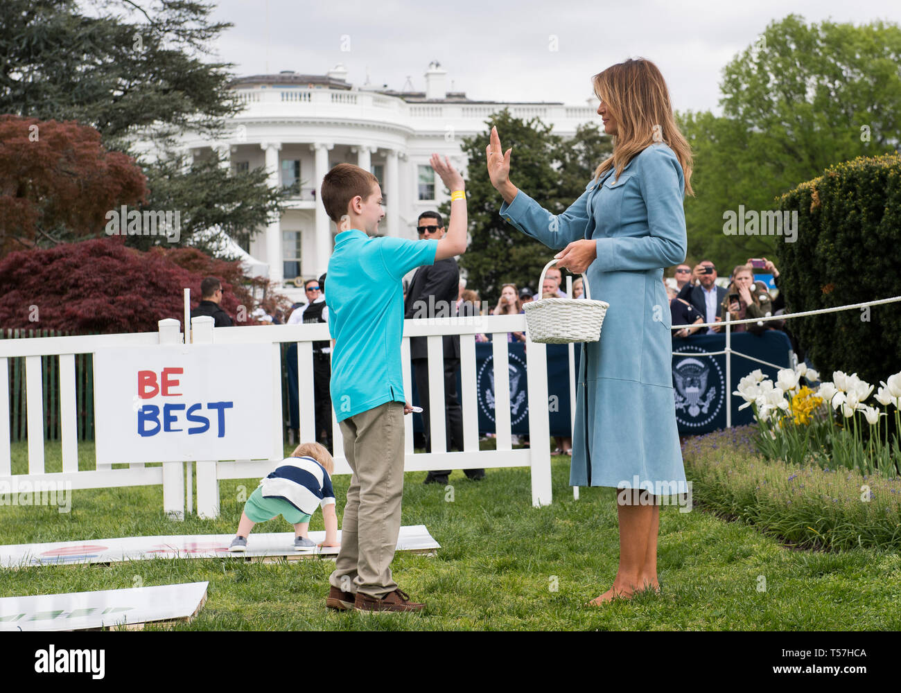 Washington, United States Of America. 22nd Apr, 2019. A child 'high fives' First Lady Melania Trump during the White House Easter Egg Roll at the White House in Washington, DC on April 22, 2019. Credit: Kevin Dietsch/Pool via CNP | usage worldwide Credit: dpa/Alamy Live News - Stock Image