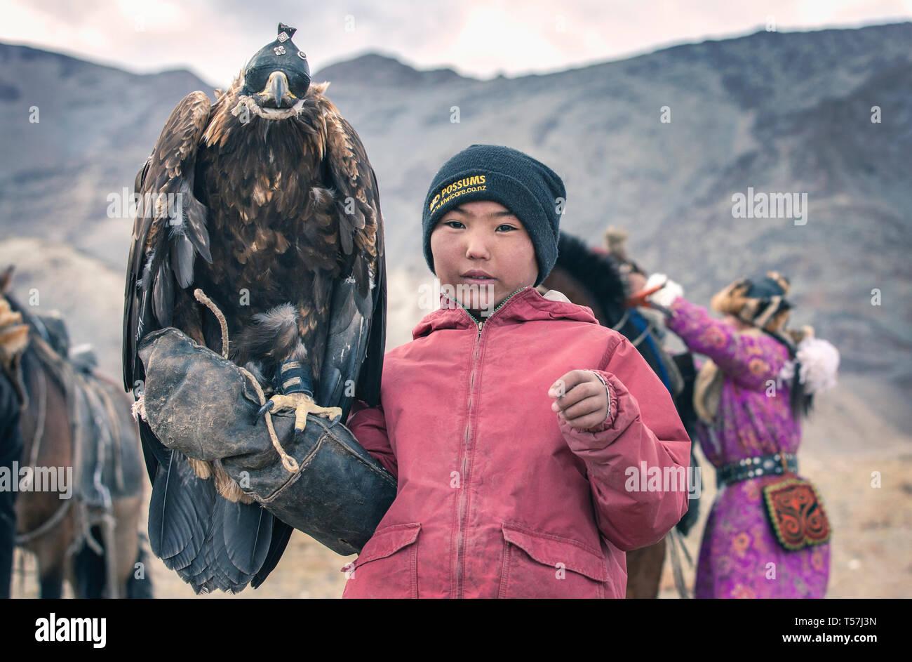 bayan Ulgii, Mongolia, 3rd October 2015: kazakh eagle hunter with his bird Stock Photo