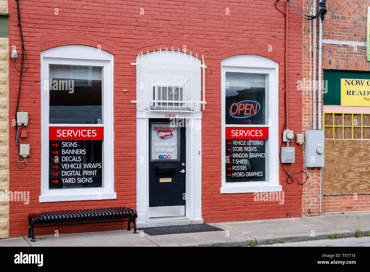 HOPE MILLS, NC - CIRCA April 2019 : Trade Street Signs Graphics Banners, Decals, Vehicle Wraps Stock Photo