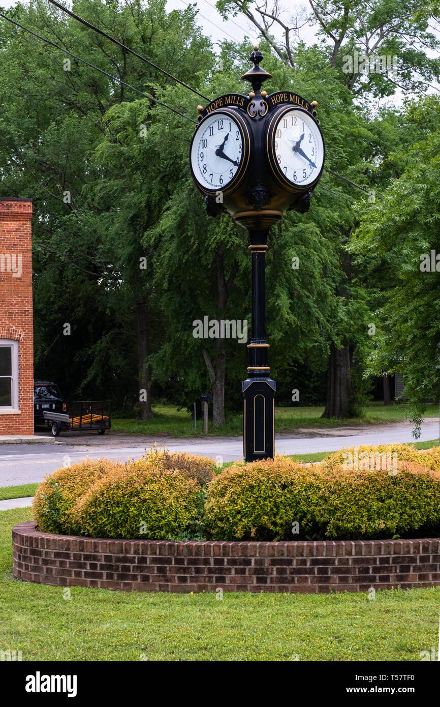 HOPE MILLS, NC - CIRCA April 2019 : Town Clock on Main Street Stock Photo