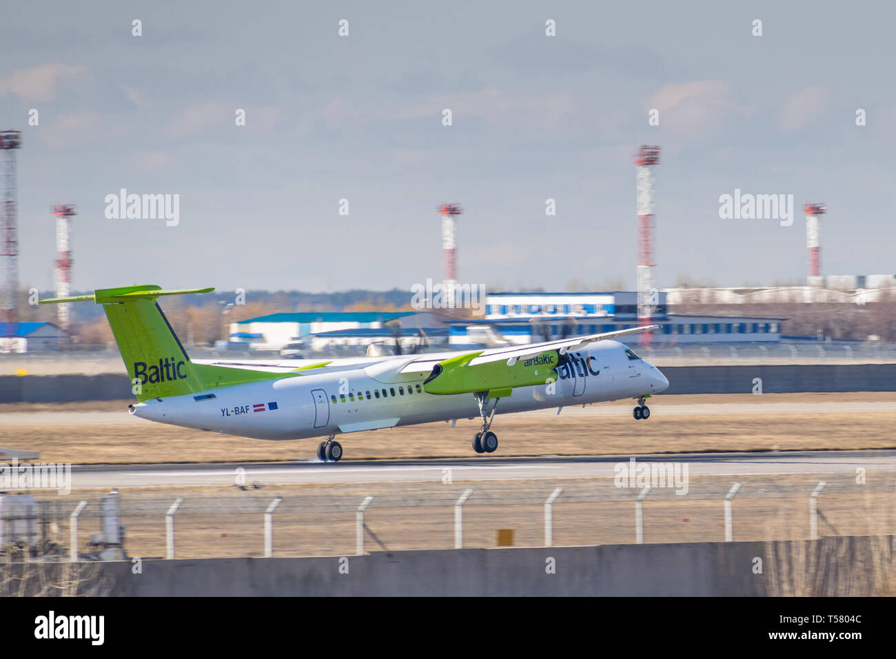 Kyiv, Ukraine - March 17, 2019: Air Baltic De Havilland Canada DHC-8-400 taxiing to the runway in the airport - Stock Image