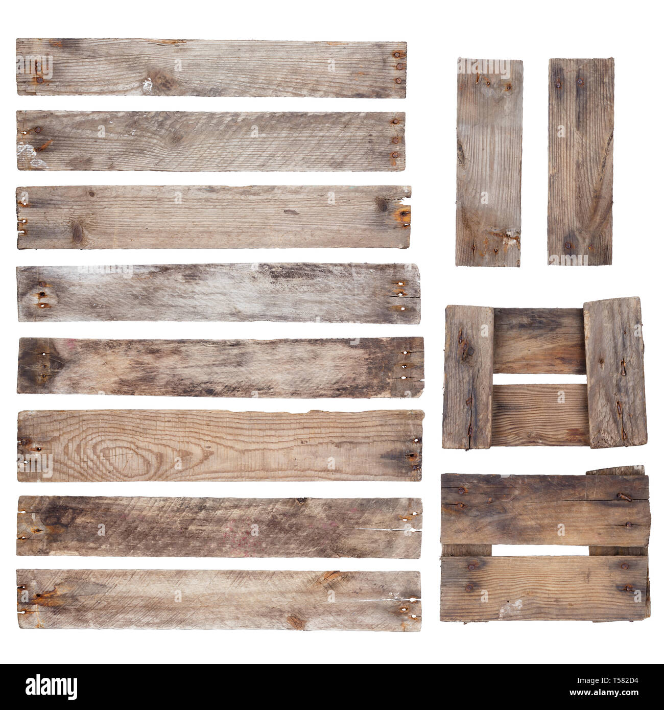 Weathered old wooden planks with rustic nails isolated on white background - Stock Image