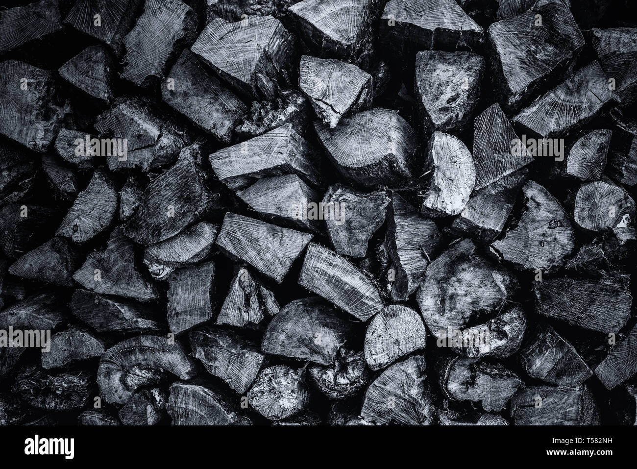 Pile of wood for burining in a wood burner, barbeque, or fire.  Timber log pile Stock Photo