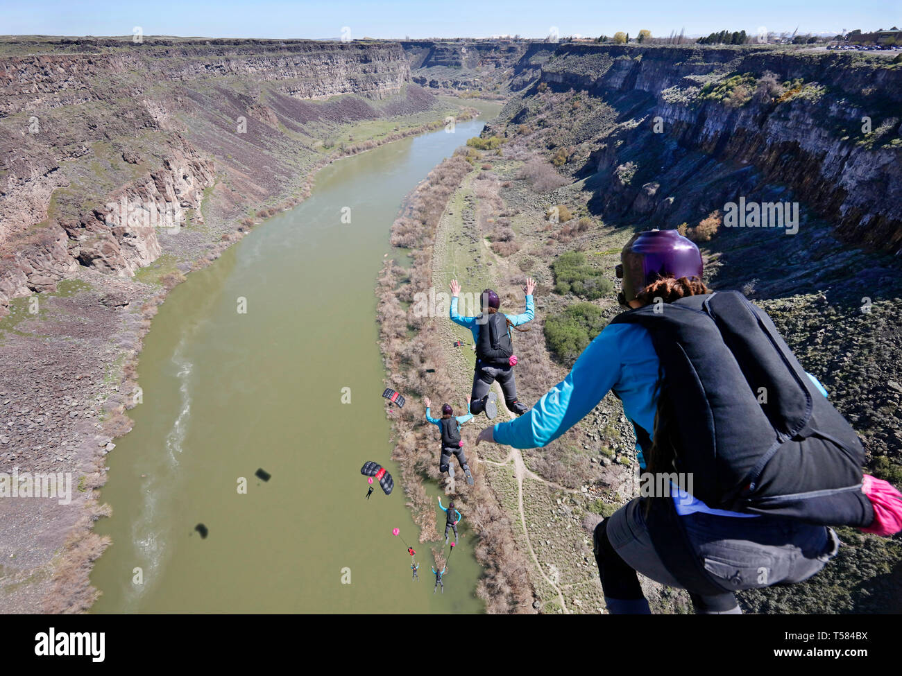 Multiple exposures of base jumper. View from the top of the Perrine Bridge, landing on the shore of the Snake River Canyon in Idaho. Stock Photo