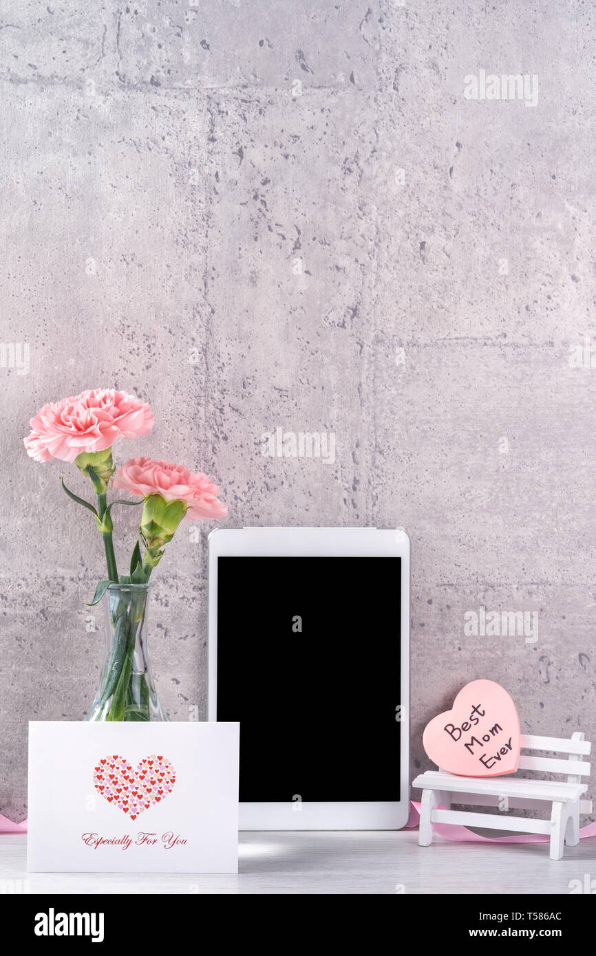 Home Decor With Blooming Carnation And Tablet As Photo Frame Beside Wall On The Table Close Up Copy Space Mock Beautiful Mothers Day Concept Stock Alamy