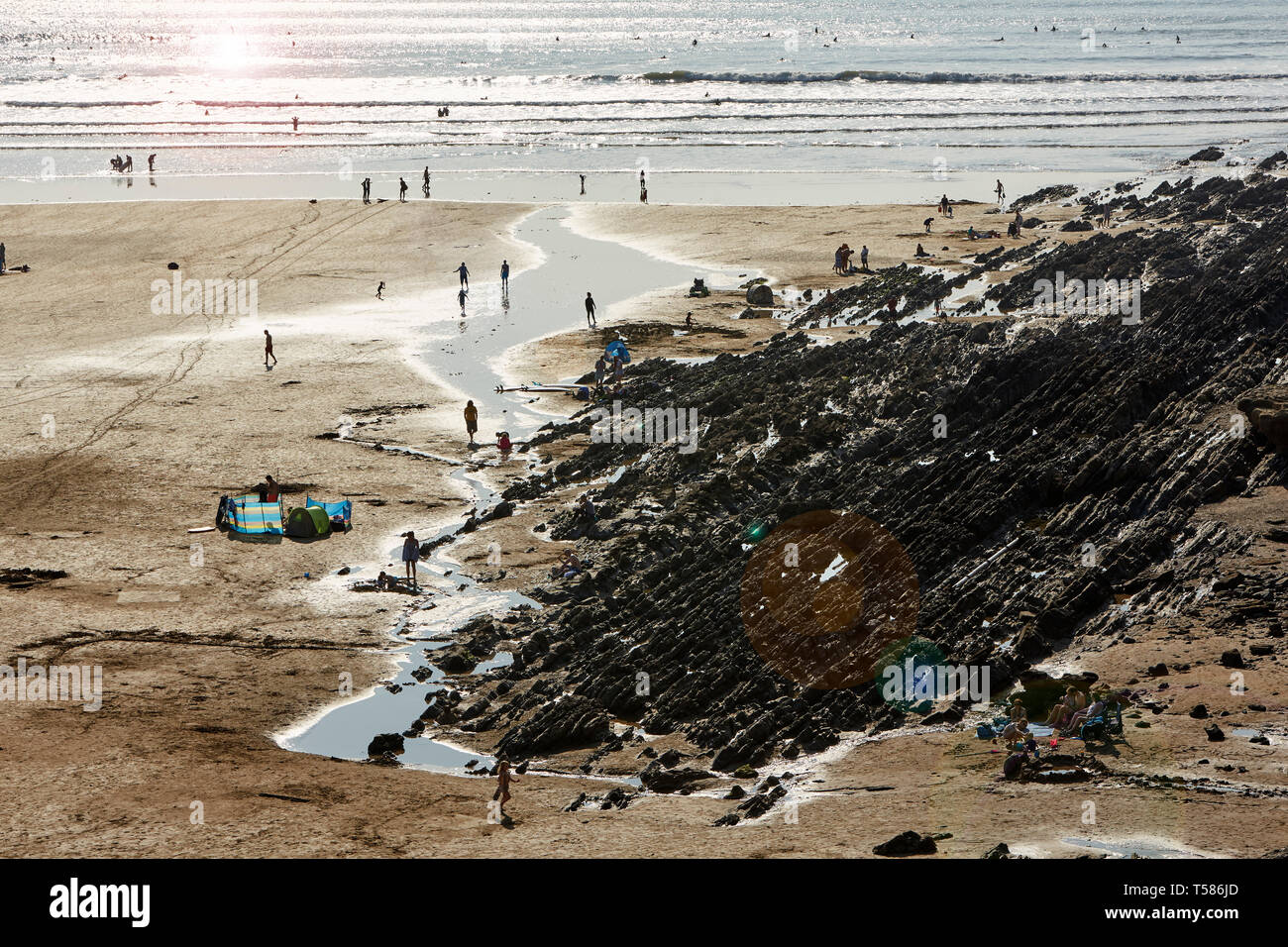 Elevated view of Tourists on Saunton Sands beach in North Devon during Easter 2019 heat wave with surf - Stock Image