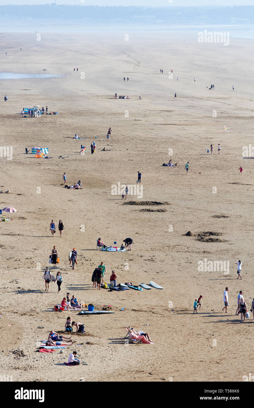 Tourists on Saunton Sands beach in North Devon during Easter 2019 heat wave - Stock Image