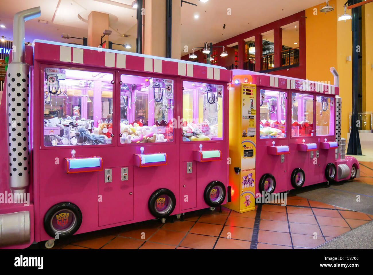Kuala Lumpur,Malaysia - April 13,2019 : Colorful arcade game toy claw crane machine where people can win toys and other prizes which is located in the - Stock Image