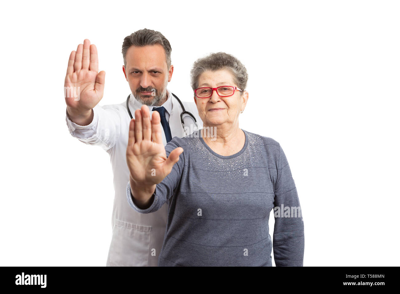 Female patient and doctor man with serious expressions holding palm up as wait gesture isolated on white background - Stock Image